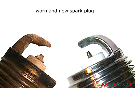 a worn spark plug gap and a new spark plug