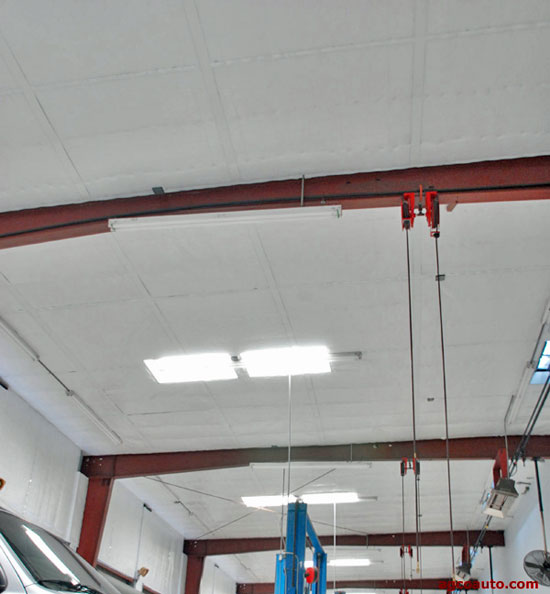 Double insulating the AGCO Automotive repair shop area saves energy and improved lighting